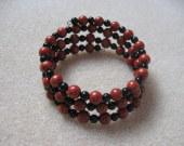Sponge coral and onyx memory bracelet