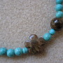 Turquoise and bronzite necklace detail