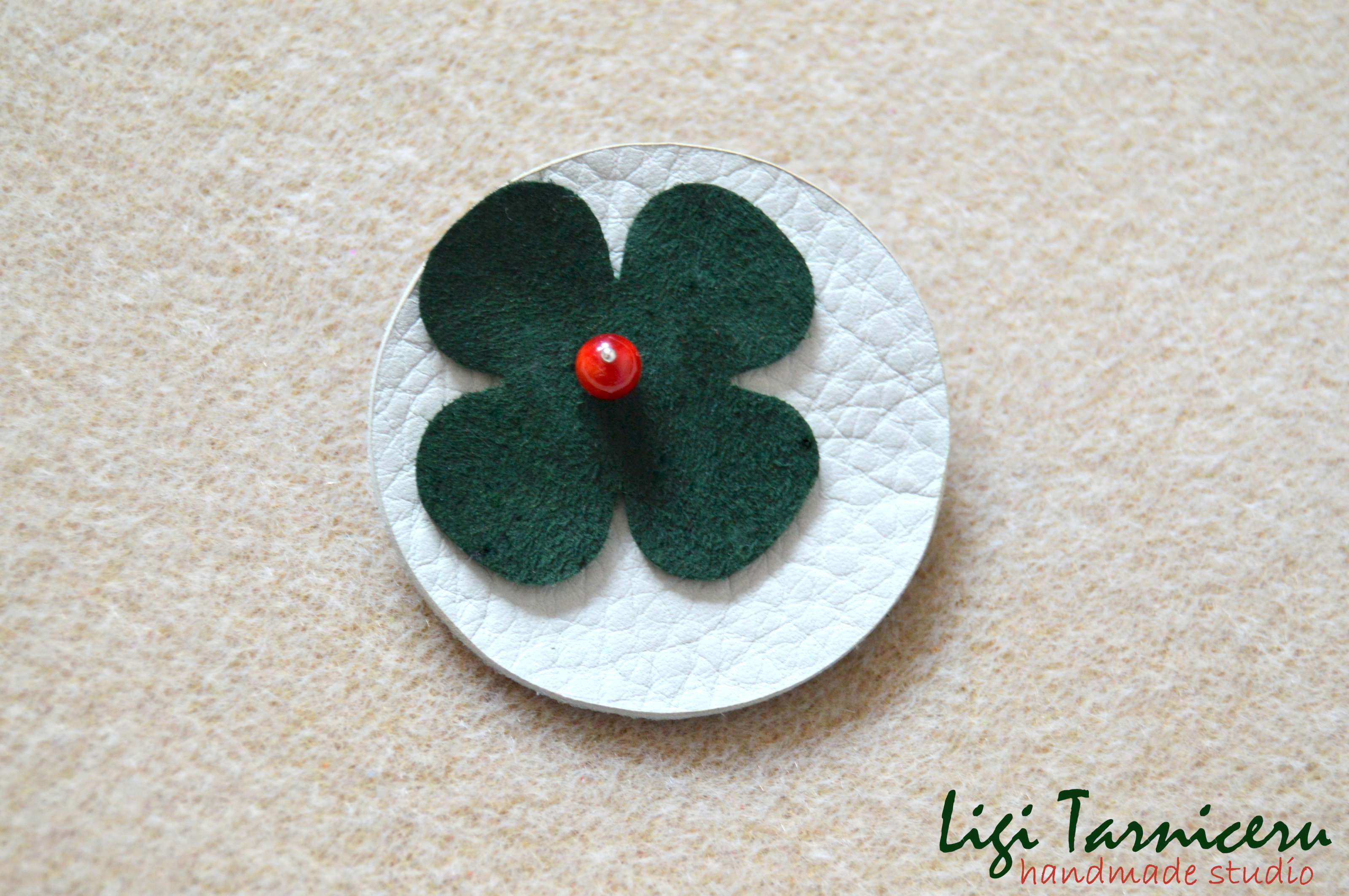 Leather, suede and bamboo coral brooch