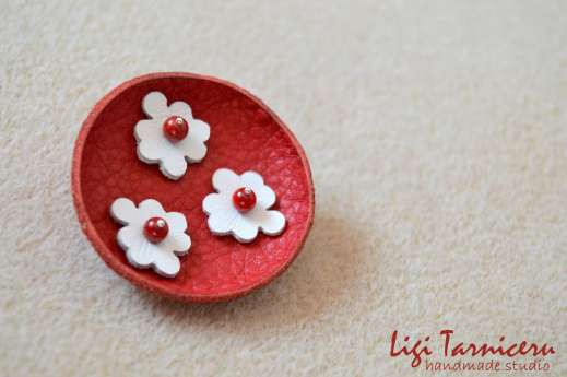 Leather and bamboo coral brooch