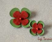 Leather, suede and bamboo coral brooches