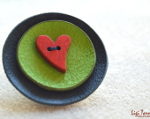 Leather brooch with red wooden heart